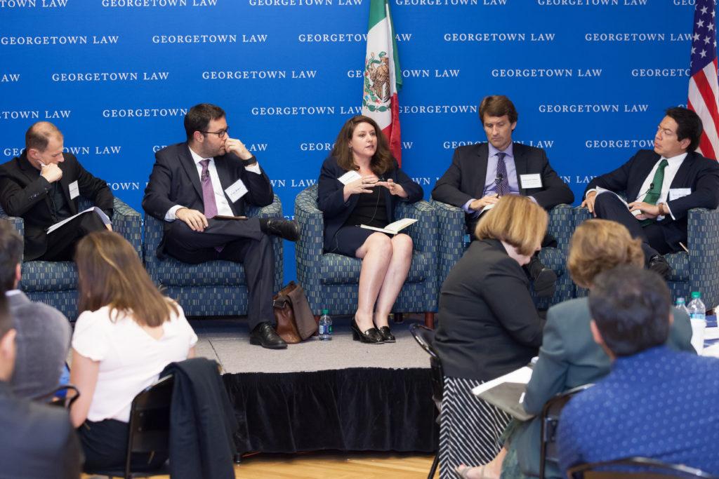 Professor Carnes, Dany Bahar, Celeste Drake, Edward Alden, and Mario Delgado on stage