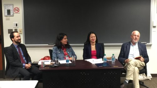 Discussants, moderator, and author in classroom