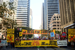 Protestors march in downtown San Francisco ahead of the Global Climate Action Summit.