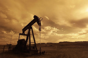 An oil pump, presumably extracting oil in a parcel of barren land.