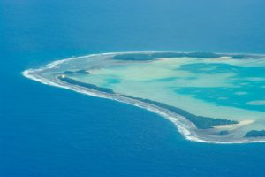 The effects of climate change, including sea level rise and intense heat, threaten to make places like the island nation of Tuvalu uninhabitable within the next several decades.