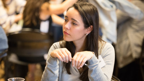 Fact-Finding Practicum student Ingrid Schulz watches her colleagues present the team's findings at the 2019 Dash Conference