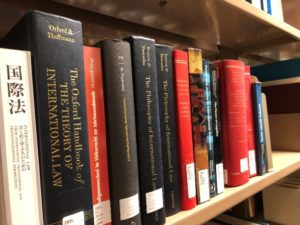 Showing multiple books on a shelf.