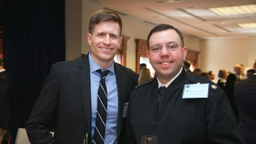 A member of the Control Team and the sim's Attorney General meet face to face after the sim, at the closing reception