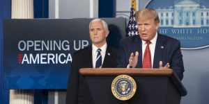 """President Trump speaking at a podium with Vice President Pence behind him. They are at a press conference to announce the """"Opening of America"""" Plan"""
