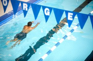 student swimming laps in the Georgetown Law pool