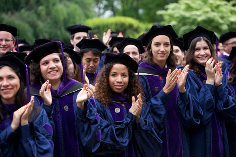 Students clapping at commencement ceremony