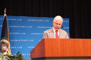 Professor from Practice Andrew I. Schoenholtz speaks at a podium at the 14th Annual Immigration Law and Policy Conference at Georgetown Law on September 25 (photo courtesy Migration Policy Institute)