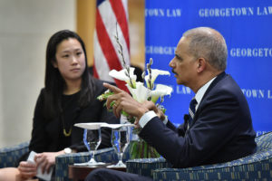 Outgoing Georgetown Law Journal Editor-in-Chief Jennifer Ong (L'18) interviews former Attorney General Eric Holder at the GLJ's Sixth Annual Banquet on March 23.