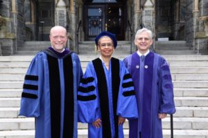 Georgetown Law Dean William M. Treanor with honorary degree recipients, D.C. Delegate Eleanor Holmes Norton and Judge Merrick Garland, at Commencement 2018 on May 20.