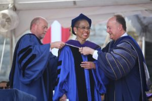 Georgetown Law Dean William M. Treanor and University President John J. DeGioia award an honorary degree to D.C. Delegate (and Commencement speaker) Eleanor Holmes Norton at the 2018 Law Center Commencement.