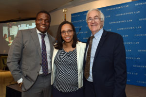 Professor Rick Roe (right), who is retiring after more than 30 years directing Georgetown Law's Street Law Program, poses with Acting Director Charisma Howell and Street Law Student Alum Patrick Campbell (C'92)