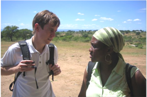 Student Advocate Nicolas Mitchell with local attorney supervisor, Sibonelo Mdluli, of Women and Law in Southern Africa – Swaziland, preparing to interview participants at a rural community gathering. His team was exploring the laws and practices that denied women access to communal land and private property.