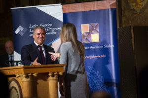 Ana Elena Khouri (LL.M.'19), president of Georgetown Law's Colombian Law Students Association, welcomes Colombian President Iván Duque Márquez (MPM'07) in Georgetown University's Gaston Hall, as Law Center Dean William M. Treanor looks on.