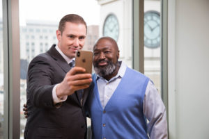 Professor Shon Hopwood and his former client, Matthew Charles, celebrate at Georgetown Law on February 6, the day after Charles was recognized by President Donald Trump at the State of the Union Address.