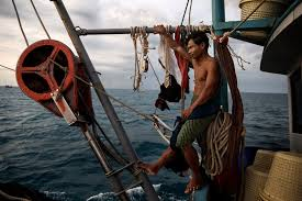 Worker on a fishing trawler in the South China Sea