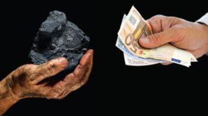 Hands exchanging coal for money