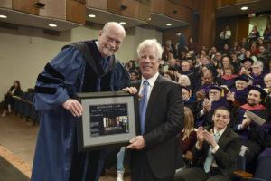 Dean William M. Treanor presents a gift to Scott K. Ginsburg (L'78).