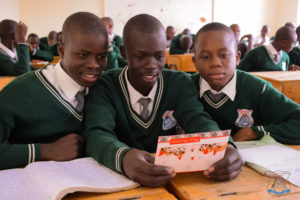 Students at St. Aloysius in Nairobi read letters and cards from Georgetown students.