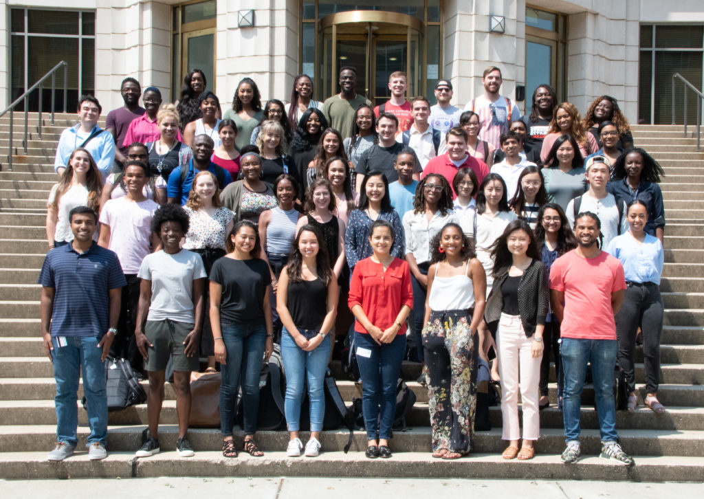The 2018-2019 RISE Fellows Cohort standing on the McDonough Hall steps. Students are all smiling and wearing various casual clothes.