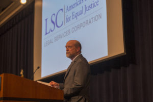 Dean William M. Treanor welcomes attendees at the Legal Service Corporation's Forum on Increasing Access to Justice, in Georgetown Law's Hart Auditorium on April 9.
