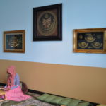 Student reading book in Muslim Prayer Room