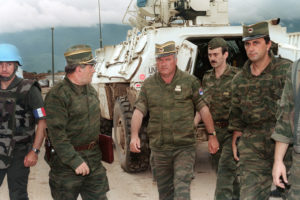 The recent PBS documentary FRONTLINE examines the war crimes trial of one of the most infamous figures from the Balkan wars of the 1990s, Ratko Mladic (pictured). Glenna Macgregor (L'05) and Arthur Traldi (L'06) both served on the prosecution team at The Hague during the trial and appeared in the documentary. Trial began in May 2012 and the verdict was delivered in 2017. (Mladic photo by Gabriel Bouys/AFP/Getty Images, courtesy of FRONTLINE.)