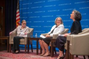 Justice Ruth Bader Ginsburg, onstage in Hart Auditorium, chats with Ruthanne Deutsch and Adjunct Professor Dori Bernstein.