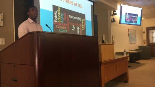 Kendall Spencer (LAW 2020) speaking in front of a projected screen at the 2018 Power for Storytelling workshop