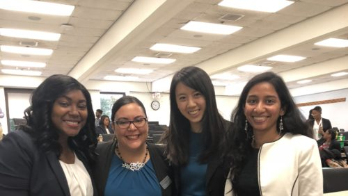 Pérez-Caro and three Georgetown Law alumnae smiling and looking at the camera