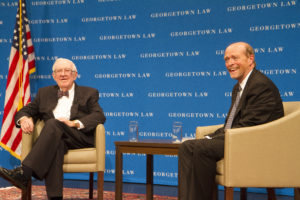 Retired Justice John Paul Stevens is pictured with Dean William M. Treanor in Georgetown Law's Hart Auditorium in this October 1, 2014, file photo. Stevens died July 16, 2019.