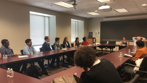 Students, staff, and faculty sit at tables in a classroom, discussing the Victory Institute LGBT Congressional Interns Pipeline Program