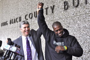 "Justin Brooks (LL.M.'92) and Brian Banks celebrated in 2012 after Banks's wrongful conviction was reversed by a California court. This scene outside the courthouse is depicted in the ""Brian Banks"" movie, in theaters on August 9, with Greg Kinnear playing Brooks and Aldis Hodge playing Banks. (Photo Courtesy California Innocence Project.)"