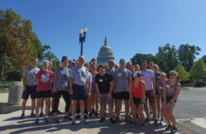 Professor Bob Thompson, Barb Moulton and Laura DeMouy take students on a jog on the Mall.