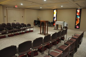 Chairs and alter set up for service in the St. Thomas Moore Chapel