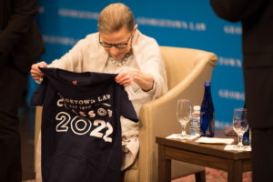 Justice Ruth Bader Ginsburg receives a Georgetown Law Class of 2022 t-shirt.