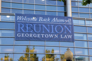 Alumni Welcome Back sign on the outside of the Ginsburg Sport and Fitness Center.