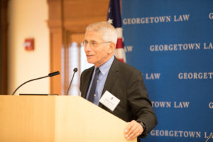 Dr. Anthony Fauci standing at podium.