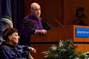 Judge Robert A. Katzmann, seated, and Associate Dean John Mikhail, at podium.