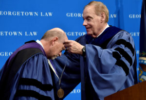 Dean William M. Treanor receives medal from Associate Dean James V. Feinerman.