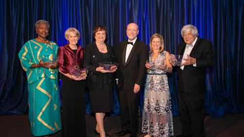 Paul R. Dean Awardees Don Burris, Devarieste Curry, Beth McCann, Ann Beth Stebbins and Drinan Awardee Barabara D. Underwood pose for photo with Dean Treanor.