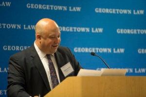 Professor Adam Levitin at podium.