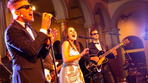 Steel Toe Stiletto plays to a large crowd of alumni at the National Building Museum at the 2018 Reunion Gala!