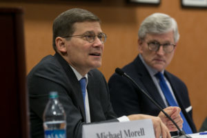 Michael Morell (M.A.'84), former acting director of the CIA, and Georgetown Law Professor Mitt Regan.