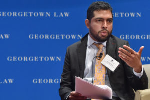 "Indi Dutta-Gupta of Georgetown Law's Center on Poverty & Inequality moderates a panel on homelessness at ""The Color of Surveillance: Monitoring of Poor and Working People"" at Georgetown Law on November 7."