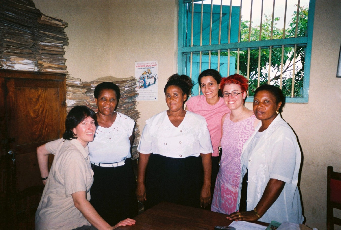 Two Student Advocates, Kalsoom Malik and Vanessa Brocato, standing with three other women in the Women's Legal Aid Centre office in Dar es Salaam.