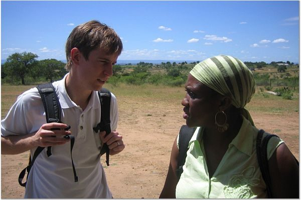 Student Advocate Nicolas Mitchell speaking with local attorney supervisor, Sibonelo Mdluli, in the field