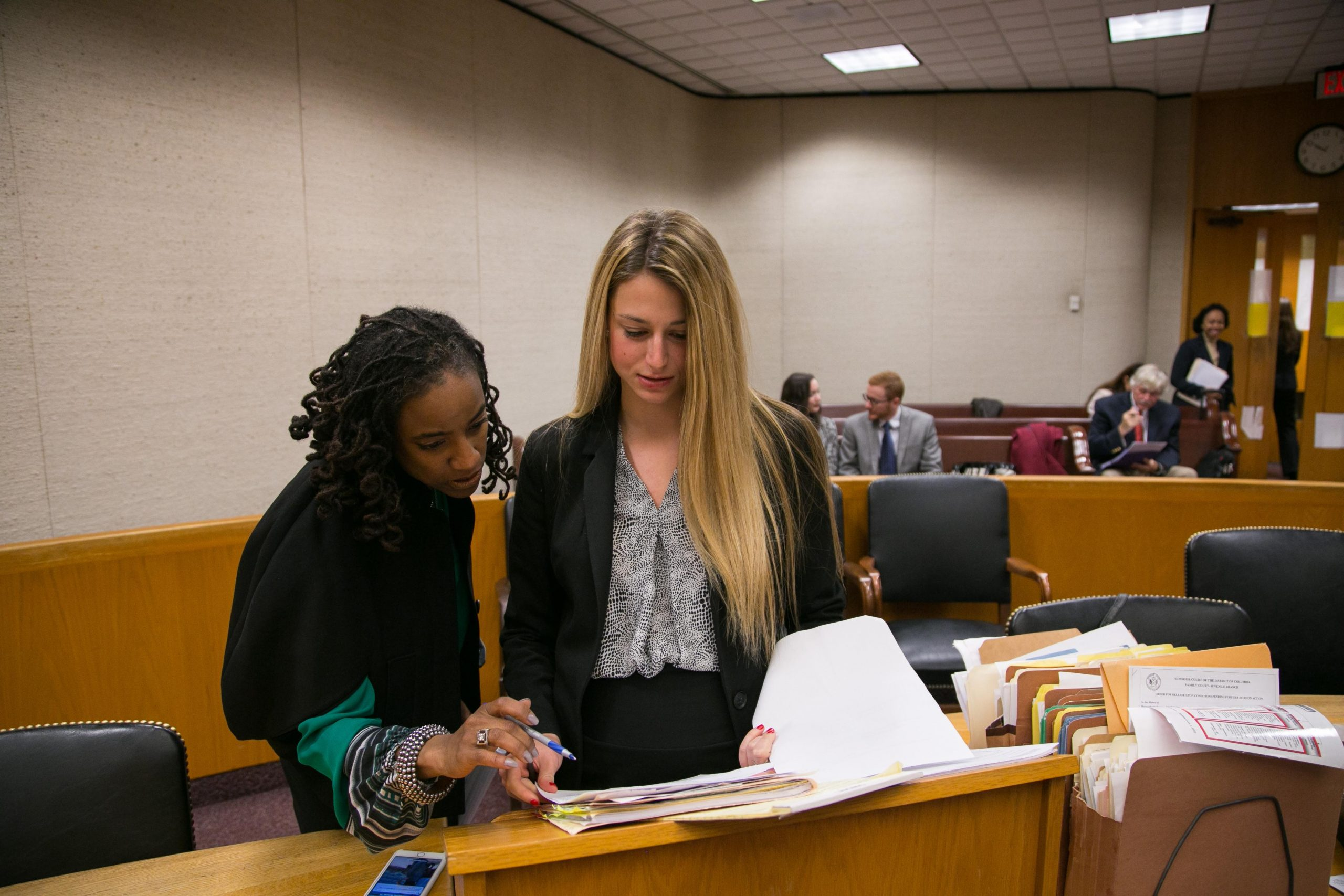 Professor Kristin Henning assists a Student Attorney in court