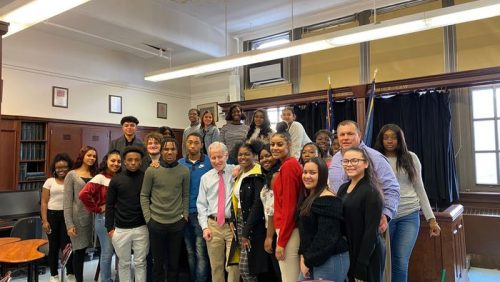 Dean Cornblatt posing with Curtis High School students