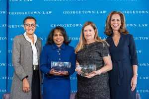 Georgetown Law Associate Dean for Centers and Institutes Elizabeth Hayes Patterson (left) and Georgetown University Alumni Association Director Julia Farr (right, C'88, P'19, P'21) at the Georgetown Law Women's Forum, giving the 2020 Georgetown Law Alumnae Award to Leslie Thornton (L'83, L'16, second from left) and U.S. District Judge Virginia M. Hernandez Covington (second from right, L'80). The Alumnae Award was established in 1998 to recognize women graduates of the Law Center who exhibit excellence in their profession and dedication to Georgetown Law.